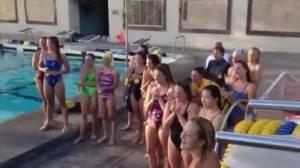 women swim sing fight song